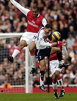Photo: Olly Greenwood.<br />Arsenal v Tottenham Hotspur. The Barclays Premiership. 02/12/2006. Arsenal's Gilbreto jumps above Tottenham's Aaron Lennon
