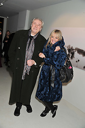 LEIGH LAWSON and TWIGGY at a private view of Bill Wyman - Reworked held at the Rook & Raven Gallery, 7 Rathbone Place, London W1 on 26th February 2013.