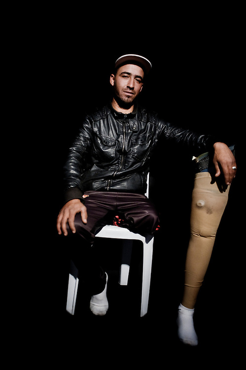 Tunis, April 2013<br /> Foued Laajili 27 years old wounded on the 18th January 2011. He got out of his house to check an assemblage in the street, a stray bullet stroke  him. He was carried unconscious to the hospital. When he woke up his leg was amputeted.