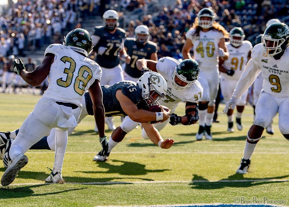 Sacramento State Hornets defensive back Marte Mapu (15), dives for a touchdown to lead 21-3 after the point after attempt was good during the 65th Causeway Classic football game between the Sacramento State Hornets and the UC Davis Aggies at Mackay Stadium at  the University of Reno, Saturday Nov 17, 2018. The game was moved there due to the bad air quality in Sacramento due to the Camp Fire.