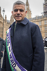© Licensed to London News Pictures. 04/03/2018. LONDON, UK. Sadiq Khan, Mayor of London, joins the march. Hundreds of men and women take part in the annual March 4 Women campaigning for gender equality.  The walk through central London from Millbank to Trafalgar Square retraces the steps of Suffragette's ahead of International Women's Day on 8 March.  Photo credit: Stephen Chung/LNP