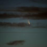 Comet PanSTARRS glows between cloud layers at Denver, Colorado 3/14/13