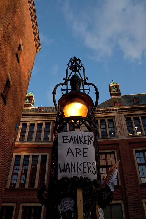 Bankers are Wankers poster outside the Amsterdam Stock Exchange, site of the Occupy Amsterdam demonstration at Beursplein, Amsterdam, the Netherlands. This is one of many 'occupy' protests fallowing the Occupy Wall Street protests in New York, against economic inequality. October 19th 2011.