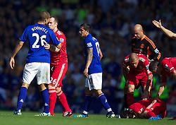 LIVERPOOL, ENGLAND - Saturday, October 1, 2011: Liverpool's Charlie Adam talks to Everton's Jack Rodwell after the Everton player was shown the red card during the Premiership match at Goodison Park. (Pic by Vegard Grott/Propaganda)