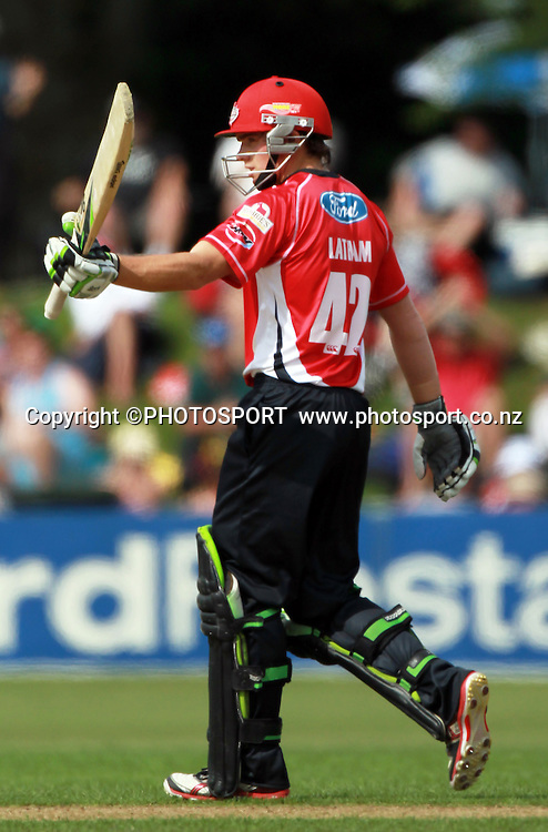 Wizards player Tom Latham raises his bat after reaching his 50 runs. Canterbury Wizards v Central Stags. HRV Cup, Twenty20 men's cricket match, Mainpower Oval, Rangiora, Sunday 8 January 2012. Photo : Joseph Johnson / photosport.co.nz