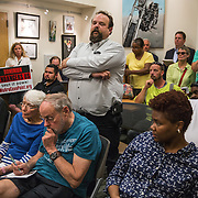 WALDORF, MD - AUG20: Sean Straser, representing his Steamfitters Union, makes public comments in favor of the proposed gas-fired power plant to the Maryland Public Service Commission, August 20, 2015, at the Charles County Public Library in Waldorf, Maryland. The plant would become the fifth plant in a 13-mile radius in southern Maryland and drew a standing room only crowd to comment on the record. (Photo by Evelyn Hockstein/For The Washington Post)