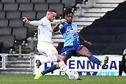 Milton Keynes Dons forward (on loan from Norwich) Carlton Morris (23) takes a shot at goal under pressure from Wycombe Wanderers defender Anthony Stewart (5) during the EFL Sky Bet League 1 match between Milton Keynes Dons and Wycombe Wanderers at stadium:mk, Milton Keynes, England on 1 February 2020.