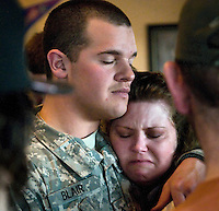 Ryan Blair, 20, hugs her cousin, Oney Pelissier, at a going-away party for Blair and his younger brother, Cory, on April 14, 2009. The brothers left Jackson as part of Wyoming's National Guard deployment to Iraq.