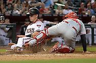 PHOENIX, AZ - JUNE 26:  Jake Lamb #22 of the Arizona Diamondbacks safely slides into homeplate in front of Andrew Knapp #34 of the Philadelphia Phillies during the third inning at Chase Field on June 26, 2017 in Phoenix, Arizona.  (Photo by Jennifer Stewart/Getty Images)