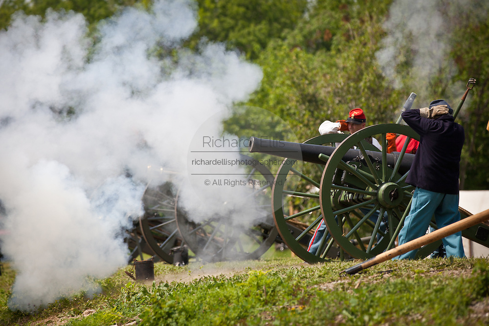 Confederate re-enactors fire a 6-inch canon aimed at Fort Sumter in Charleston Harbor Charleston, SC. The re-enactors are part of the 150th commemoration of the US Civil War.