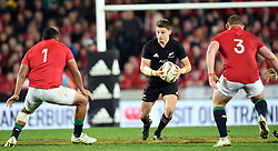 Beauden Barrett of New Zealand, centre, splits the defence of Mako Vunipola of the Lions, left and Tadhg Furlong of the Lions in the third International rugby test match between the the New Zealand All Blacks and British and Irish Lions at Eden Park, Auckland, New Zealand, Saturday, July 08, 2017. Credit:SNPA / Ross Setford  **NO ARCHIVING""