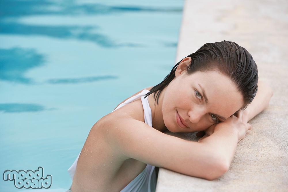 Women resting in swimming pool portrait
