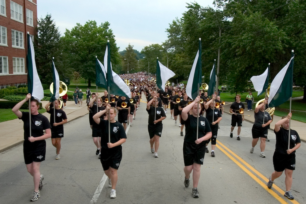 "The Marching 110 lead the 2006 freshman class up Richland Avenue toward the College Green...OPENING SCHOOL IN STYLE -- Members of the 2006 freshman class at Ohio University will get their college careers off on the right foot, both literally and figuratively, with the traditional march through the College Gate at approximately 3:15 p.m. Monday, Sept. 4. Following the President's Convocation at 2:30 p.m. in the Convocation Center, the new Bobcats will follow ""The Most Exciting Band in the Land,"" the Marching 110, from the Convo for the trek up Richland Avenue toward the College Green as they officially begin their college careers..Once on the College Green, representatives of more than 200 student organizations across campus will have displays set up to introduce the newest Ohio University students to the many ways to become actively involved in campus life..It is a colorful tradition that captures the spirit of college life. It also makes for tremendous photo and video opportunities for a unique twist on the conventional moving-in activities as the academic years of schools, colleges and universities across the state hit full stride over Labor Day Weekend."