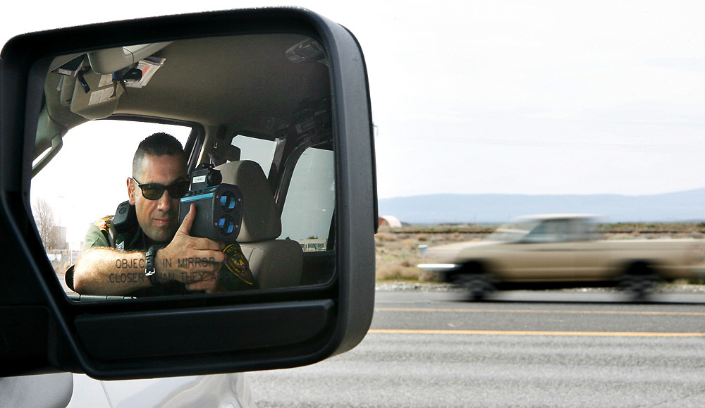 Benton County sheriff's Deputy Dave Hughes checks the speed of motorists leaving Hanford. The sheriff's office doesn't anticipate any problems with increased traffic during rush hour due to jobs created by stimulus funds.