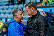 Coventry City Manager Mark Robins  and Notts County Manager Kevin Nolan during the EFL Sky Bet League 2 match between Coventry City and Notts County at the Ricoh Arena, Coventry, England on 12 May 2018. Picture by Simon Davies.