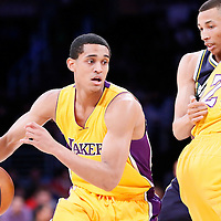 19 March 2015: Los Angeles Lakers guard Jordan Clarkson (6) drives past Utah Jazz guard Dante Exum (11) on a screen set by Los Angeles Lakers forward Tarik Black (28) during the Utah Jazz 80-73 victory over the Los Angeles Lakers, at the Staples Center, Los Angeles, California, USA.
