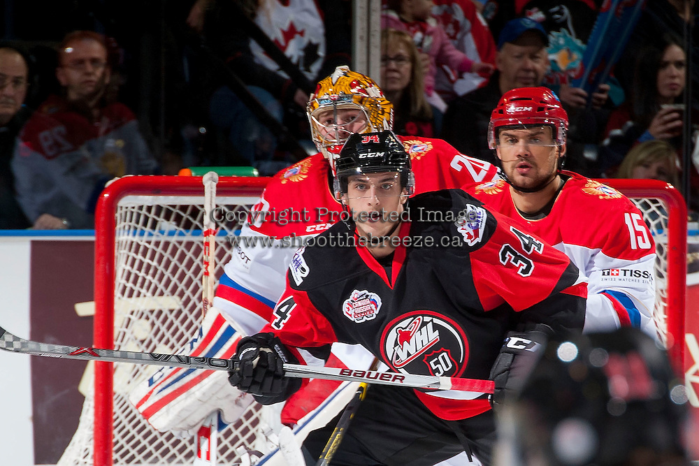 KELOWNA, CANADA - NOVEMBER 9: Ivan Igumnov #15 of Team Russia checks Deven Sideroff #34 of Team WHL on November 9, 2015 during game 1 of the Canada Russia Super Series at Prospera Place in Kelowna, British Columbia, Canada.  (Photo by Marissa Baecker/Western Hockey League)  *** Local Caption *** Ivan Igumnov; Deven Sideroff;