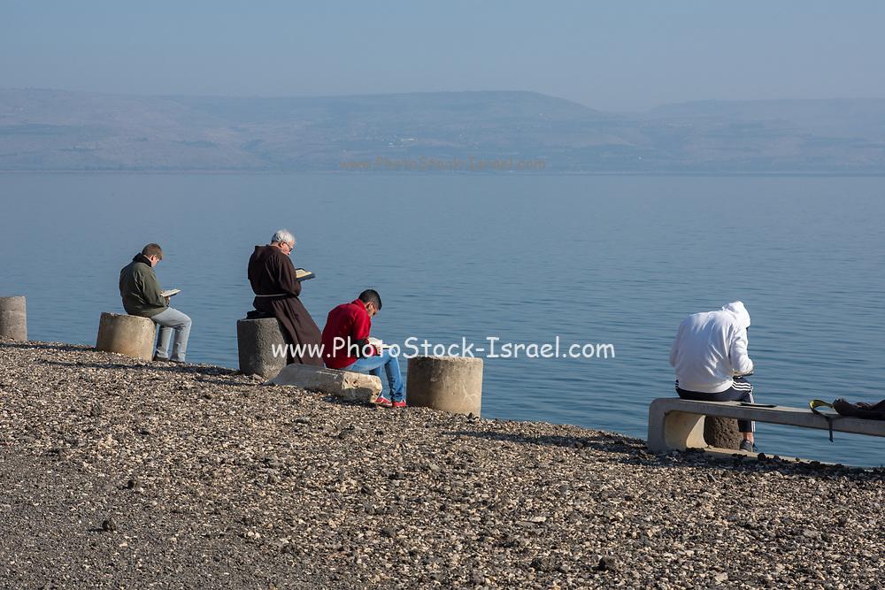 Praying at the Sea of Galilee at the Fransican Monastery at Capernaum, Israel