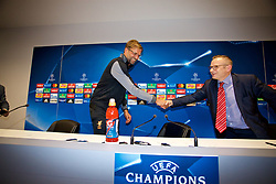LIVERPOOL, ENGLAND - Tuesday, August 22, 2017: Liverpool's manager Jürgen Klopp shakes hands with the interpreter during a press conference at Anfield ahead of the UEFA Champions League Play-Off 2nd Leg match against TSG 1899 Hoffenheim. (Pic by David Rawcliffe/Propaganda)