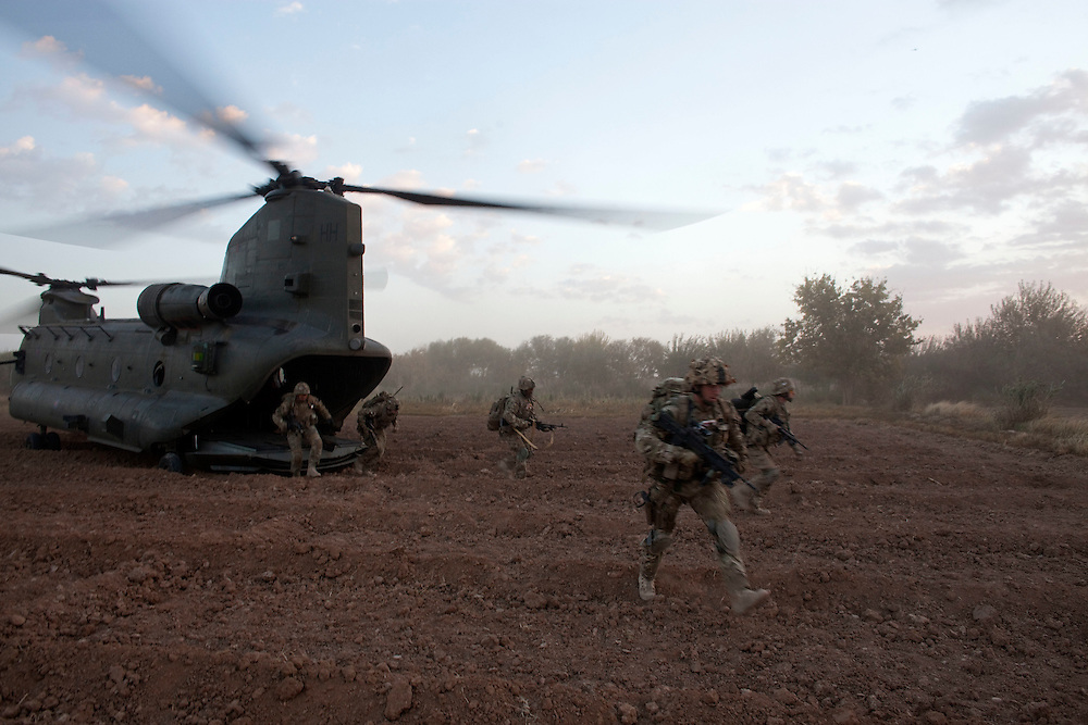 British soldiers from 1 PWRR (Princess of Wales's Royal Regiment)  and from the Black Watch deploy from the back of a CH-47 Chinook near to Loya Manda,  as part of Operation Tora Pishaw 5 in Nad e Ali North, Helmand Province, Afghanistan on the 11th of November 2011.