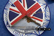 Sliced Union Jack cake at a neighbourhood street party in Dulwich, south London celebrating the Diamond Jubilee of Queen Elizabeth. A few months before the Olympics come to London, a multi-cultural UK is gearing up for a weekend and summer of pomp and patriotic fervour as their monarch celebrates 60 years on the throne and across Britain, flags and Union Jack bunting adorn towns and villages.