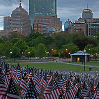 Boston photography from New England based fine art photographer Juergen Roth showing the Garden of American Flags in the Boston Common on Memorial Day. The Military Heroes Garden of American flags in Boston Common displays nearly 37000 American flags, each flag represents the lost life of a fallen service member from Massachusetts since the Revolutionary War (1775 to 1783) to the present in 2014. Visitors are reminded of the essence of the Memorial Day holiday through this deeply moving site.<br />