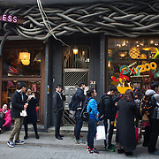 A line of lunchers next to a trendy shop called Homeless. a line of lunchers next to trendy shop called Homeless. 7 million people live on 1,104km square, making it Hong Kong the most vertical city in the world.