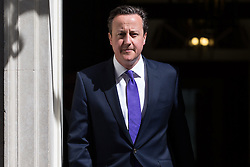 © Licensed to London News Pictures . 11/05/2015 . London , UK . The British Prime Minister , DAVID CAMERON , leaves 10 Downing Street this morning (11th May 2015) . Photo credit : Joel Goodman/LNP