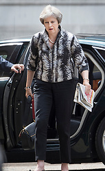 © Licensed to London News Pictures. 16/07/2018. London, UK. Prime Minister Theresa May arrives at the back of Downing Street. Earlier, Justine Greening MP said in an interview with The Times that a second referendum on leaving the EU should be held. Photo credit: Peter Macdiarmid/LNP