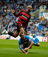 Photo: Ed Godden.<br /> Reading v Queens Park Rangers. Coca Cola Championship. 30/04/2006. Kevin Doyle (Reading) is brought down in the area by QPR's George Santos. No penalty given.