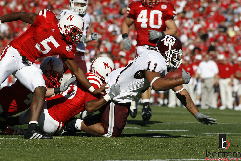 Texas A&M running back Jorvorskie Lane is pulled down by Nebraska defenders on Saturday, Oct. 20, 2007 at Memorial Stadium in Lincoln, Nebraska. Texas A&M won the game 36-14.