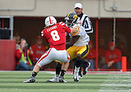 November 25, 2011: Iowa Hawkeyes wide receiver Marvin McNutt (7) tries to spin away from Nebraska Cornhuskers safety Austin Cassidy (8) during the first half of the NCAA football game between the Iowa Hawkeyes and the Nebraska Cornhuskers at Memorial Stadium in Lincoln, Nebraska on Friday, November 25, 2011. Nebraska defeated Iowa 20-7.