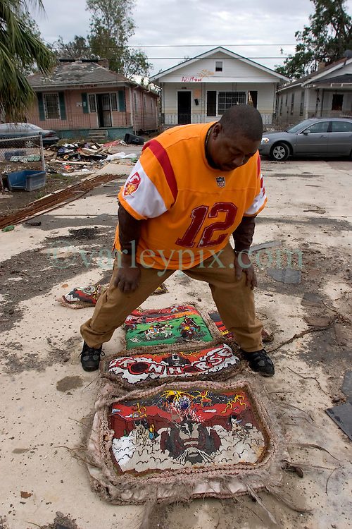 10 December, 05.  New Orleans, Louisiana.  Post Katrina aftermath.<br /> A lavish Mardi Gras Indian costume is laid out in the front yard of a devastated home in Gentilly, New Orleans.<br /> Photo; &copy;Charlie Varley/varleypix.com