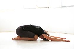 Man Practicing Yoga, Child's pose