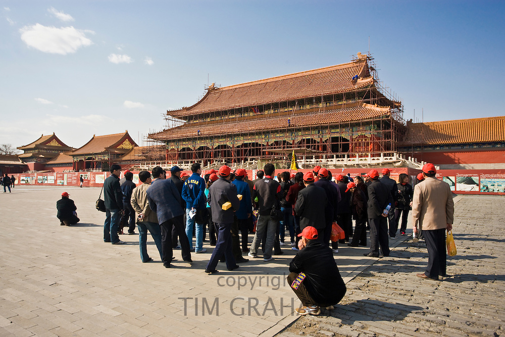 Tourists at Gate of Supreme Harmony which is undergoing renovation work, in the Forbidden City, Beijing, China