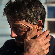 Dennis Hendrickson wipes dust from his eyes after finishing his eight-hour shift as a contract operating engineer for A. Lindberg & Sons in Palmer, Mich., on Sunday, March 3, 2012. Lukas Keapproth/Press-Gazette