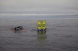 USA ALASKA CHUKCHI SEA 29JUL12 - A Greenpeace diver holds a 'Save the Arctic' banner near a two-seater submarine, on loan from the Waitt Insititute in the Chukchi Sea near a proposed Shell drill site north of Point Hope, Alaska...Photo by Jiri Rezac / Greenpeace....© Jiri Rezac / Greenpeace