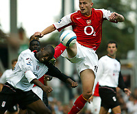 Photo. Chris Ratcliffe. Digitalsport<br /> Fulham v Arsenal. Barclays Premiership. 11/09/2004<br /> Pascal Cygan of Arsenal clashes with Luis Boa Morte of Fulham