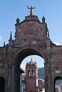 An arch and the Church of San Pedro, Cusco, Peru