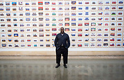 Steve McQueen Year 3 Exhibition<br /> at Tate Britain, London, Great Britain <br /> Press view <br /> 11th November 2019 <br /> <br /> Steve McQueen - artist and film maker <br /> <br /> The Turner Prize-winning artist and Oscar-winning filmmaker has created one of the most ambitious visual portraits of citizenship ever undertaken in one of the world's largest cities. Using the medium of the traditional school class photograph, this installation brings together images of tens of thousands of Year 3 pupils from across London. It offers us a glimpse of the city's future - a hopeful portrait of a generation to come.<br />  <br /> <br /> Visitors interacting part of the installation<br /> <br /> A portrait of Turner Prize-winning artist and Oscar-winning filmmaker Steve McQueen with Tyssen Community School in the Duveens Galleries <br /> <br /> <br /> <br /> Photograph by Elliott Franks
