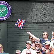LONDON, ENGLAND - JULY 13:  A British fan cheering on Johanna Konta of Great Britain in action against Venus Williams of the United States in the Ladies Singles Semi Final match during the Wimbledon Lawn Tennis Championships at the All England Lawn Tennis and Croquet Club at Wimbledon on July 13, 2017 in London, England. (Photo by Tim Clayton/Corbis via Getty Images)