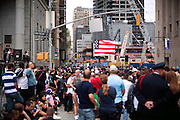 Spectators are watching live coverage on the 10th year anniversary of the 9/11 attacks on the Word Trade Centre, in Lower Manhattan, New York, USA.