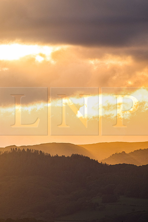 ©Licensed to London News Pictures. 21/.06/2019. Borth, UK. Day break over the village of Borth and the hills of the Dyfi Valley in Ceredigion, Wales , on Mid Summer's Day, the Summer Solstice, June 21 2019 the longest day of the year. Photo credit: Keith Morris/LNP