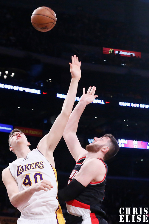 26 March 2016: Portland Trail Blazers center Jusuf Nurkic (27 goes for the baby hook over Los Angeles Lakers center Ivica Zubac (40) for the  during the Portland Trail Blazers 97-81 victory over the Los Angeles Lakers, at the Staples Center, Los Angeles, California, USA.