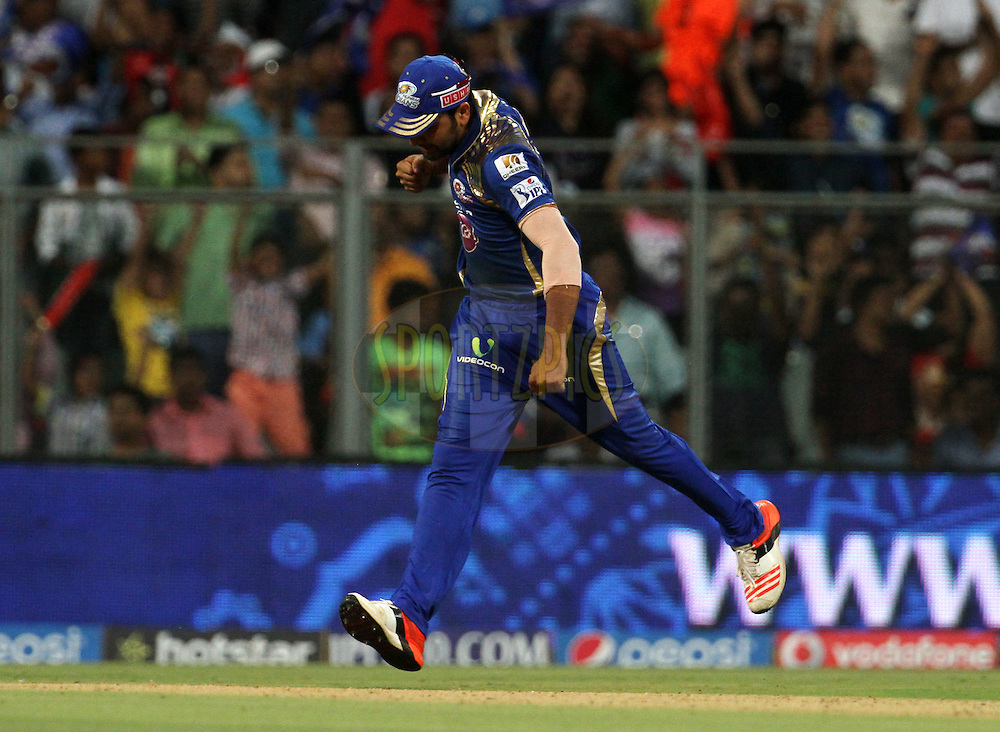 Mumbai Indians captain Rohit Sharma celebrates the wicket of Sunrisers Hyderabad player KL Rahul during match 23 of the Pepsi IPL 2015 (Indian Premier League) between The Mumbai Indians and The Sunrisers Hyderabad held at the Wankhede Stadium in Mumbai India on the 25th April 2015.<br /> <br /> Photo by:  Vipin Pawar / SPORTZPICS / IPL