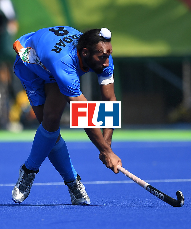 India's Sardar Singh looks on during the men's field hockey India vs Ireland match of the Rio 2016 Olympics Games at the Olympic Hockey Centre in Rio de Janeiro on August, 6 2016. / AFP / MANAN VATSYAYANA        (Photo credit should read MANAN VATSYAYANA/AFP/Getty Images)