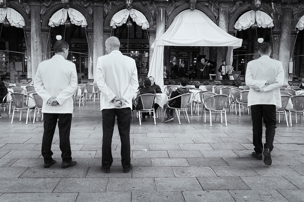 Three waiters in San Marco Plaza, Venice, Italy.