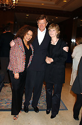 Left to right, PETRA ROACH and JOHNNY & WENDY KIDD at the Holders Season Barbados Comes to London night at The Four Seasons Hotel, Hamilton Place, London on 3rd February 2006.<br /><br />NON EXCLUSIVE - WORLD RIGHTS