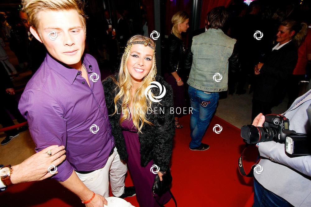 AMSTERDAM - Na het concert van De Toppers is er de welbekende VIP PARTY voor alle bekende Nederlanders. Met hier op de foto  Tim Douwsma en Monique Smit. FOTO LEVIN DEN BOER - PERSFOTO.NU