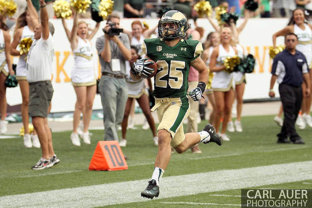 September 1st, 2013 - Colorado State Rams sophomore punt returner Joe Hansley (25) breaks down the sideline for a touchdown early in the second half of  action in the NCAA football game between the Colorado Buffaloes and the Colorado State Rams at Sports Authority Field in Denver, CO